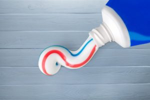 An open tube of toothpaste.