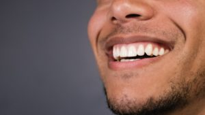 Man showing healthy gums.