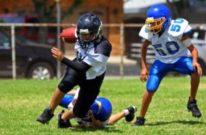 Boy playing football in pads.