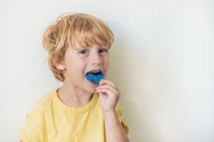 little boy with dental mouthguard