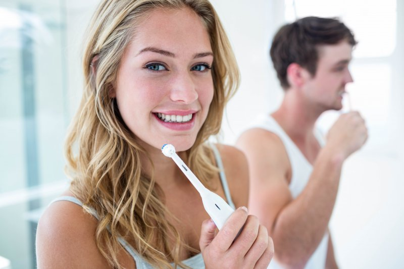 Young couple brushing their teeth together