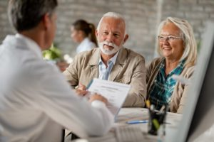 senior couple at a consultation for dental implants